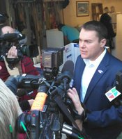 Mayoral candidate Carl DeMaio talks to reporters after voting.