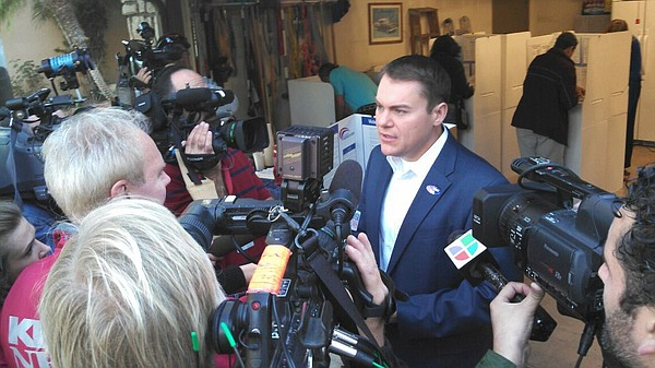 Mayoral candidate Carl DeMaio talks to reporters after vo...