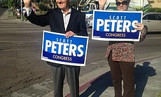 Two Scott Peters supporters, Julie Ritter and Marty Judge.