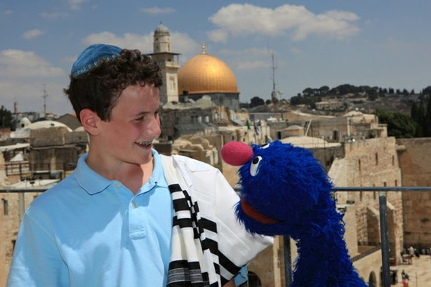 "A young boy and Grover are in Israel, from SHALOM SESAME ""It's Passover, Grover!"""