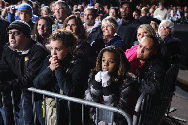 Supporters listen to President Barack Obama speak during his last rally the night before the general election November 5, 2012 in Des Moines, Iowa.