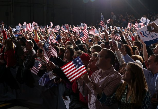 Suporters wave American flags as Republican presidential candidate, former Massachusetts Gov. Mitt Romney speaks during a campaign rally at Landmark Aviation on November 5, 2012 in Columbus, Ohio.