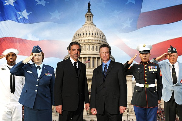 Joe Mantegna and Gary Sinise (center L to R, standing with military personnel...