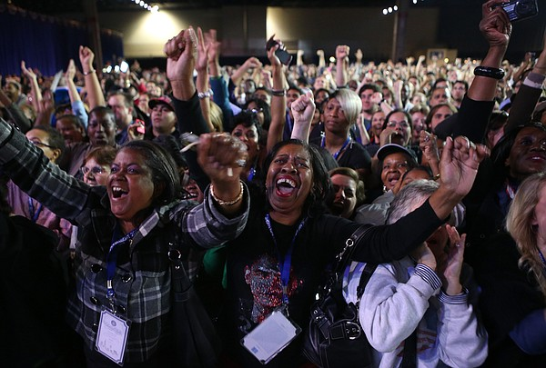 Supporters of U.S. President Barack Obama cheer during th...