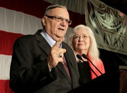 Maricopa County Sheriff Joe Arpaio with his wife, Ava, speaks to supporters during an Election Night party in Phoenix.