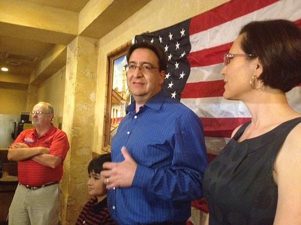 Pete Gallego, with his wife and son, thanks supporters on Election Night in S...