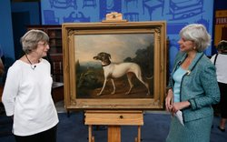 Appraiser Colleen Fesko (right) and a guest with her dog portrait.