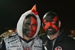 Two Xolos fans of many who painted their faces and donned costumes to show su...