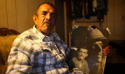 Deported Vietnam combat veteran Hector Barrios sits in his Tijuana apartment.