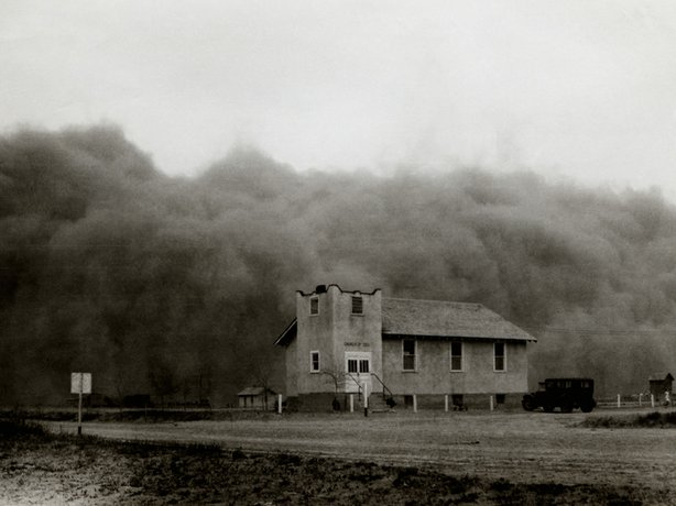 The huge Black Sunday storm - the worst storm of the decade-long Dust Bowl in the southern Plains - just before it engulfed the Church of God in Ulysses, Kansas, April 14, 1935. Daylight turned to total blackness in mid-afternoon.