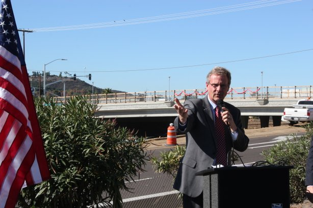 San Marcos mayor Jim Desmond marks the re-opening of the Nordahl Bridge, which is seen in the background.