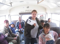 A relative of missing young woman hands out fliers to passengers of a bus headed to downtown Juárez.