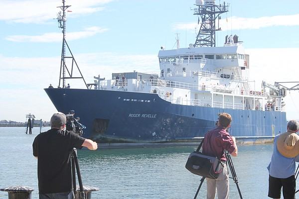 TV photographers capture the return to San Diego Bay of t...
