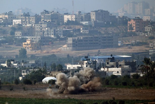 An artillery shell explodes inside the Gaza Strip on November 21, 2012 on Israel's border with the Gaza Strip.