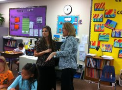 Kendall Sczempka , left, discusses her classroom with Poway Unified Teacher Consultant Michelle Manos, Oct. 30, 2012.