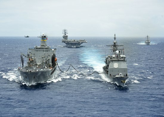 The Military Sealift Command fleet replenishment oiler USNS Henry J. Kaiser (T-AO 187), left, delivers a 50-50 blend of advanced biofuels and traditional petroleum-based fuel to the guided-missile cruiser USS Princeton (CG 59) during the Great Green Fleet demonstration portion of Rim of the Pacific (RIMPAC) 2012 exercise.