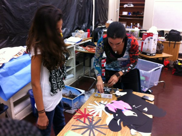 Lily Correa (left) and Karla Duarte work with construction paper that came to...