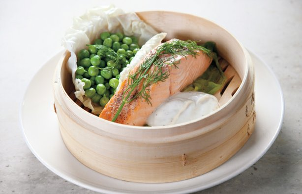 Martha Stewart uses a bamboo steamer to prepare steamed salmon and peas (pictured) simultaneously for a quick and easy dinner.