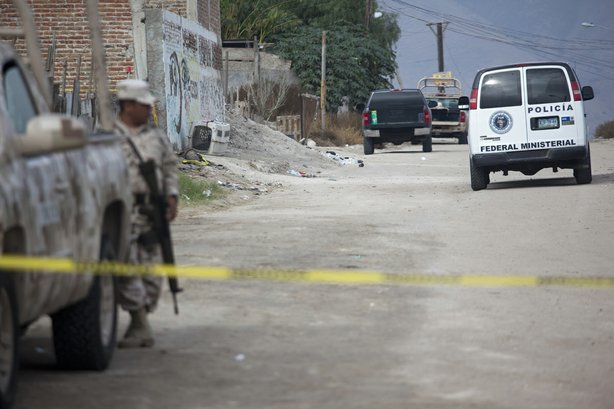 Federales, the Mexican Army, and local investigators work within the crime sc...