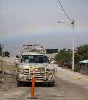 A rainbow provides a backdrop to the crime scene at La Gallera in Ejido Maclovio Rojas in Tijuana, where the remains of hundreds of dissolved bodies were found this week.