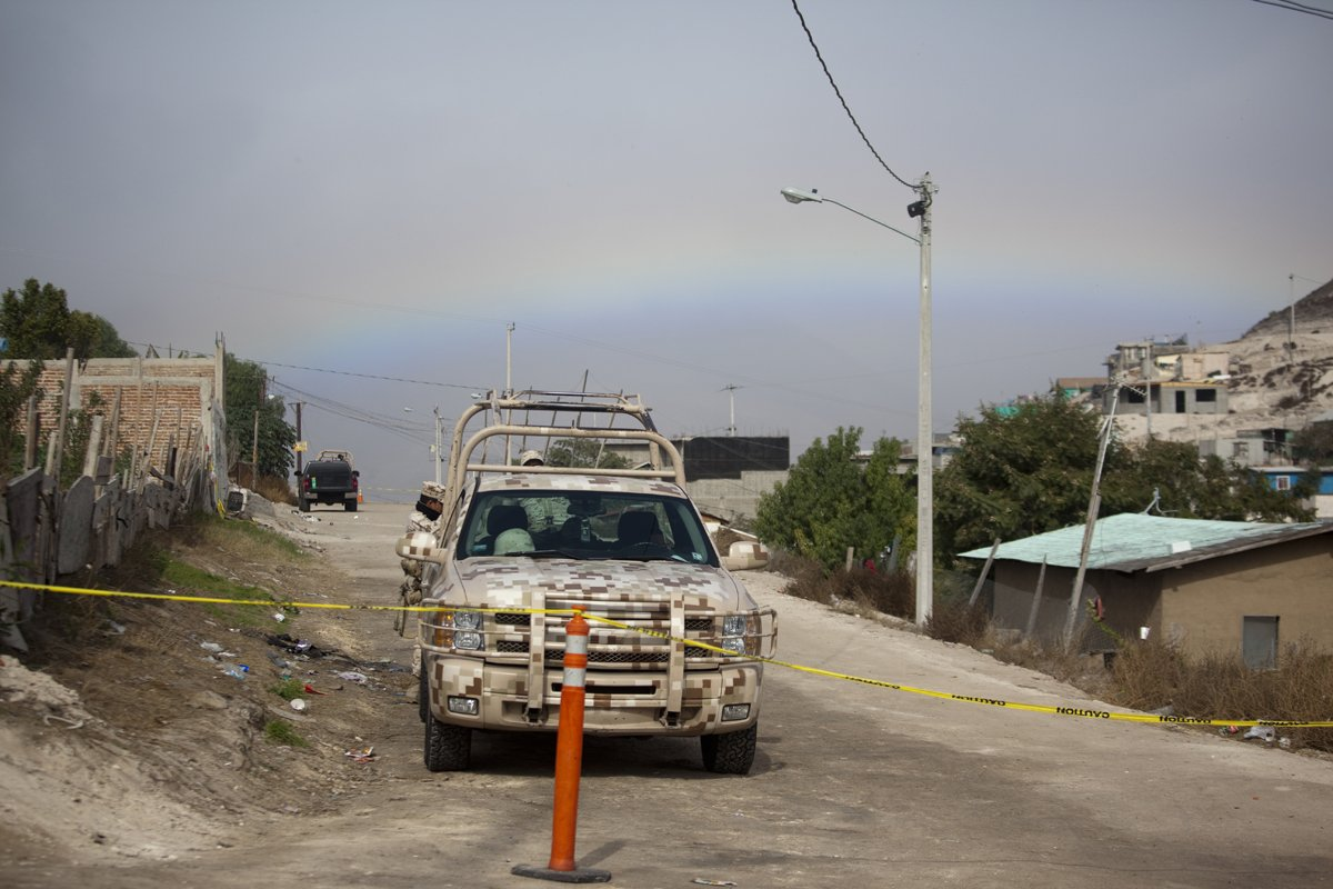 Photo By Erin Siegal A Rainbow Provides A Backdrop To The Crime Scene At  La Gallera In Ejido Maclovio Rojas