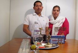 Pablo Garcia Perez with his wife, Remedios, and some of the religious Jewish objects he has acquired since immigrating to the Phoenix area.