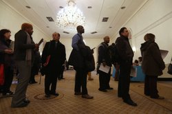 Applicants wait to meet potential employers at the Diversity Job Fair on Dece...