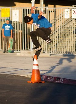 Jorge Robles shows off his skateboarding skills in front of Cherokee Point E...