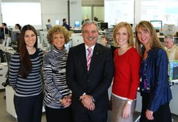 The KPBS Development department poses for a photo with General Manager Tom Karlo in the KPBS Newsroom.  (From left; Caitlin Bergin, Stephanie Bergsma, Tom Karlo, Jennifer Majors, and Trina Hester)