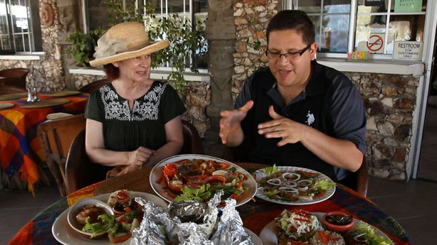 In Bahia de Los Angeles, Jorge Meraz (right) gets a chance to taste what the ocean has to offer including scallops, lobster and clams with Lucy (left), a long-time resident and local artist.
