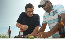Jorge Meraz learns about the oyster farming process with Carlos Guerrera, and then slurps one down with salsa and lime.