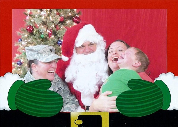 Lt. Col. Heather Mack, Ashley Broadway, and son (and Santa Claus).