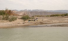 Mexican nationals on the south side of the Rio Grande at Boquillas, Mex.