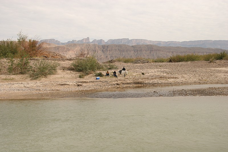 Mexican nationals on the south side of the Rio Grande at Boquillas,... ()