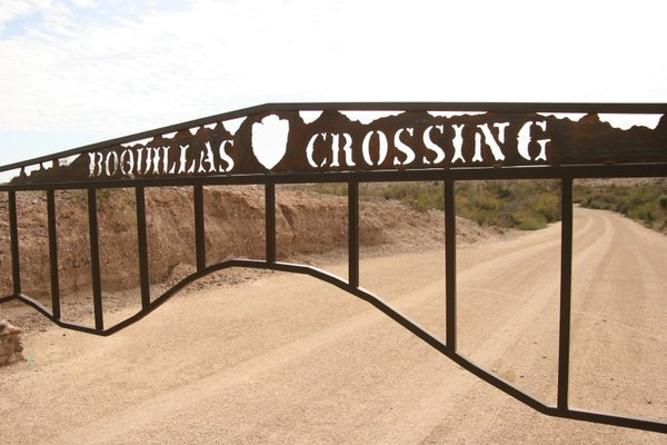 The gate leading to the river crossing into northern Mexico near the village ...