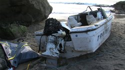 This fishing boat was being pounded by waves in a cove near Ocean Beach when coastal law enforcement authorities found it in the early morning.