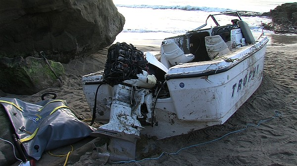 This fishing boat was being pounded by waves in a cove near Ocean Beach when ...