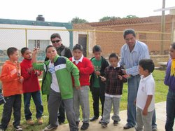 School children in the state of Zacatecas play a game of darts during recess.
