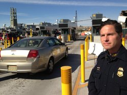 Joseph Misenhelter, an assistant port director at the border crossing between San Diego and Tijuana, stands in front of new double-stacked processing booths being installed to increase security and decrease border wait times -- eventually to 30 minutes, he hopes.