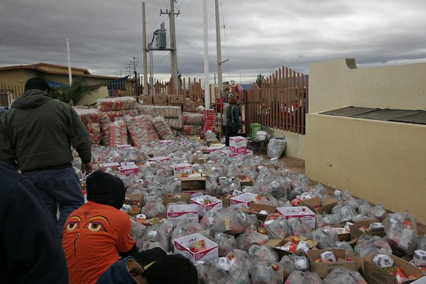 Volunteers loaded 1,000 bags with enough groceries to feed a family of four for a week at the Rancho Feliz Charitable Foundation's project in Agua Prieta, Sonora, Mex.