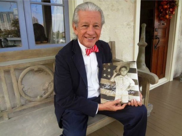 "Lionel Sosa displays the ""Children of the Revolucion"" book that goes with the documentary television series."