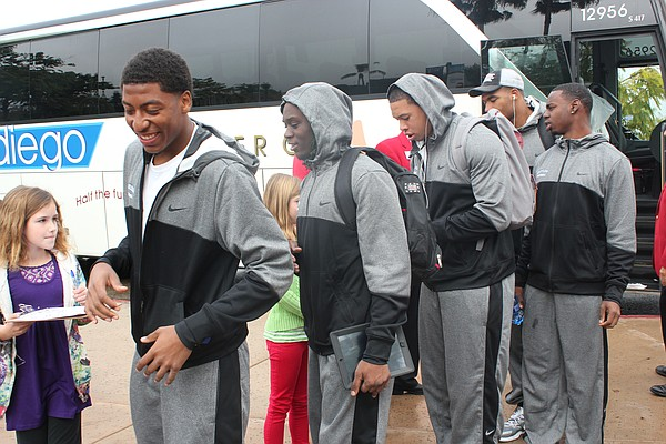 Members of the Baylor Bears football team get off the bus...