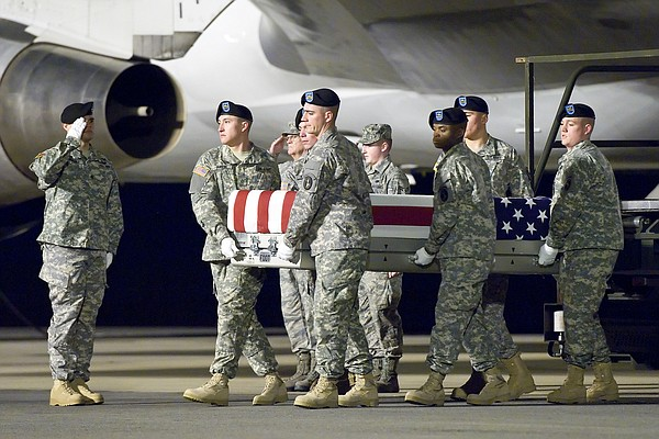 A U.S. Army carry team transfers the remains of Army Sgt....