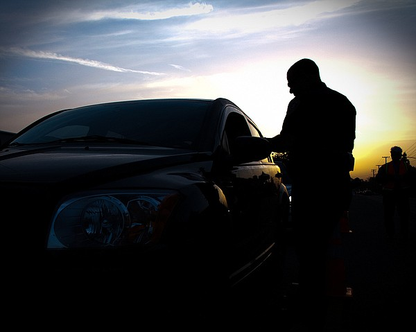 A police officer at a DUI checkpoint.