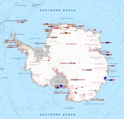 A map of Antarctica showing international research stations. The U.S. and Australia bases are marked with blue stars.