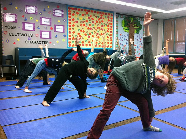 Third graders at Olivenhain Pioneer Elementary School do the Triangle pose du...