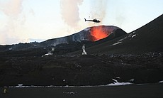 Helicopter over the crater of the Eyjafjallajök...