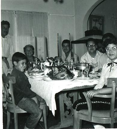 The Porras family, circa 1950, sitting at the dinner table for a holiday meal...
