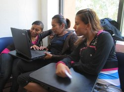 Students at Mexico's first public midwifery school study together after class.