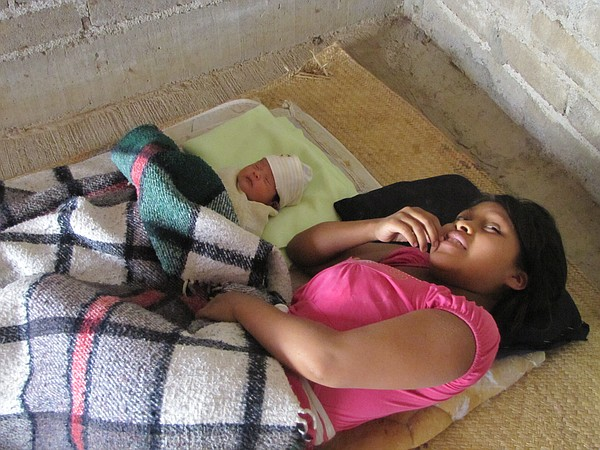 A young mother and her newborn rest in the village of Tlatquiltzingo in the s...